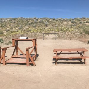 Pistol range with yellow wildflowers