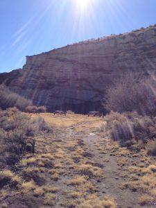 Sunlight beaming down above cliffs