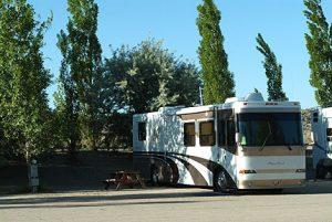 Large RV in Site with mature trees