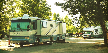 Motor home with two slides in RV site